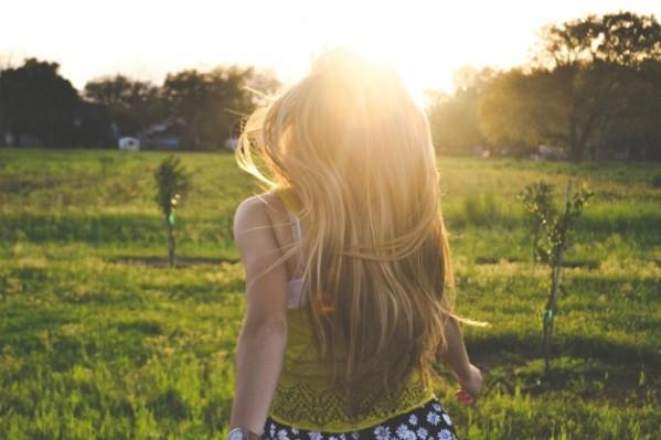 girl-walking-through-countryside_426-19324058
